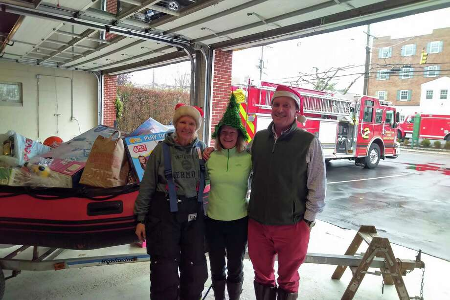 Volunteer Rowayton firefighter Silvia Doyle, aongside co-founders of the Rowayton Fire Department Toy Drive Joan DeRegt and Mike Barbis, at the Dec. 2018 Toy Drive in Norwalk, Conn. Photo: Contributed