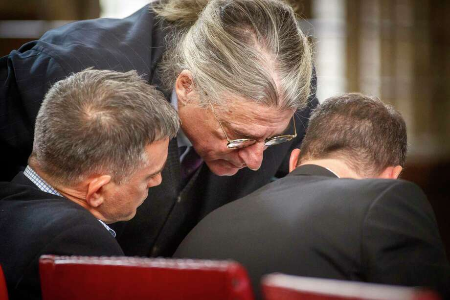 Fotis Dulos, left, confers with attorneys Norm Pattis, center, and William Murray, during a civil case Tuesday, Dec. 3, 2019, in Hartford, Conn., brought by Gloria Farber, the mother of Jennifer Farber Dulos, his estranged wife who disappeared in May of this year. Farber claims Dulos owes around $3-million in unpaid loans to the estate of her late husband Hilliard Farber. Photo: Mark Mirko / Associated Press / ?2019 The Hartford Courant