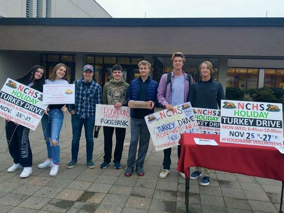 NCHS Hockey & Ski Team volunteers came out to gather donations and turkeys from local families, raising more than $2,100 and 27 turkeys to help provide the more than 18,000 turkeys needed for families this holiday season. Photo: Contributed Photo