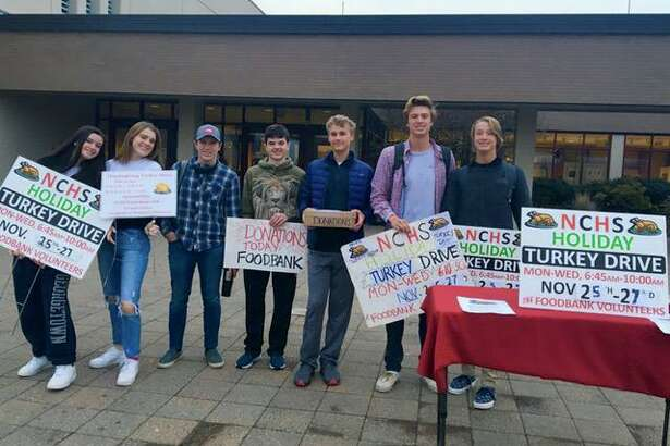 NCHS Hockey & Ski Team volunteers came out to gather donationsand turkeys from local families, raising more than$2,100 and 27 turkeys to help provide the more than 18,000 turkeys needed for families this holiday season.