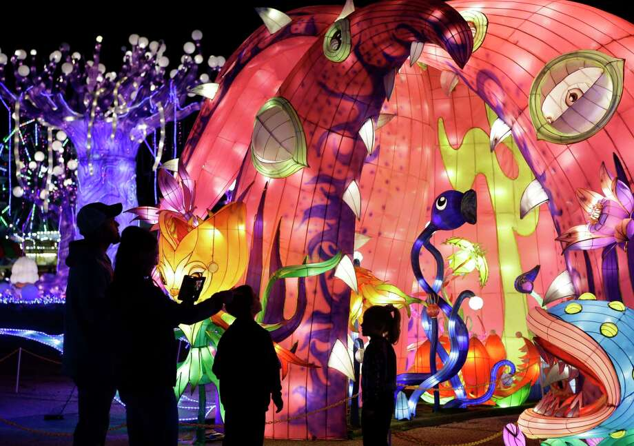 People attend the Magical Winter Nights, a lantern festival and holiday celebration, at Gulf Greyhound Park, 1000 FM 2004, Sunday, Dec. 17, 2017, in La Marque. In addition to the lantern exhibits, the event includes a carnival and Chinese acrobatic performances.  ( Melissa Phillip / Houston Chronicle ) Photo: Melissa Phillip, Houston Chronicle / Houston Chronicle / © 2017 Houston Chronicle