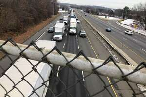 Traffic snarl shown looking southbound at Interstate 95's Exit 38 in Milford from the Forest Road overpass.