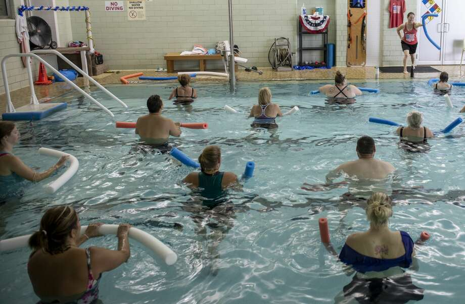 Sarah Parmer instructs Water in Motion during the Summer Jam on June 29 at the YMCA. Those who exercise have easier time falling asleep. Photo: Jacy Lewis/191 News