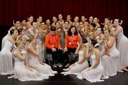 Enchanted Garden studio dancers gather around Special Olympics Ridgefield athletes Nicholas Lanzetta and Samatha Calabro.