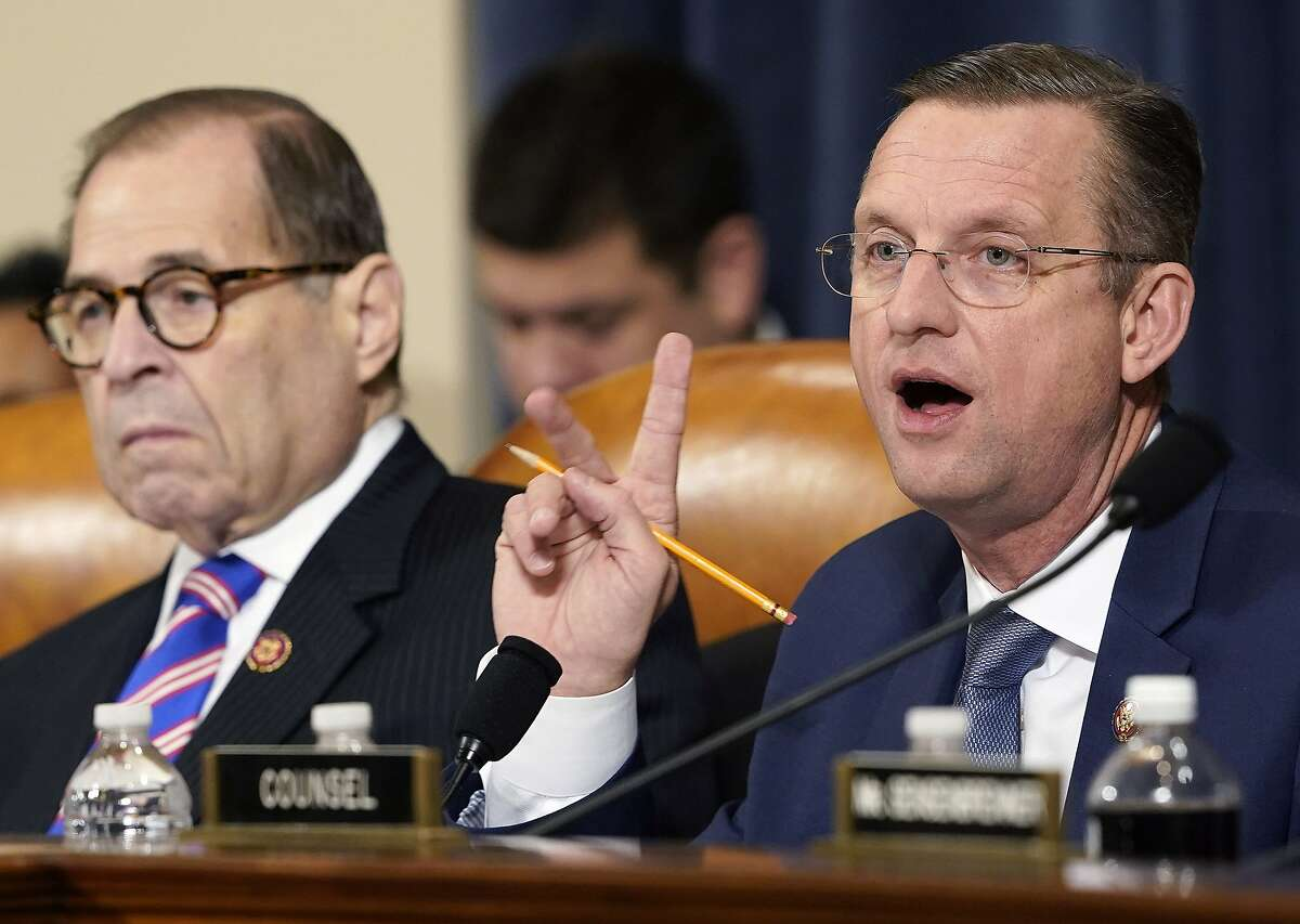 Committee ranking member Rep. Doug Collins (R) (R-GA) delivers his opening statement as committee chairman Rep. Jerry Nadler (L) (D-NY) listens during an impeachment hearing where constitutional scholars Noah Feldman of Harvard University, Pamela Karlan of Stanford University, Michael Gerhardt of the University of North Carolina, and Jonathan Turley of George Washington University testified before the House Judiciary Committee in the Longworth House Office Building on Capitol Hill December 4, 2019 in Washington, DC. This is the first hearing held by the House Judiciary Committee in the impeachment inquiry against U.S. President Donald Trump, whom House Democrats say held back military aid for Ukraine while demanding it investigate his political rivals. The Judiciary Committee will decide whether to draft official articles of impeachment against President Trump to be voted on by the full House of Representatives.