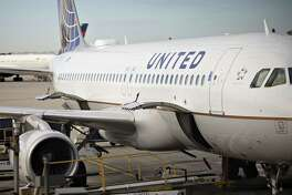 A United Airlines aircraft sits at a gate at OHare International Airport in Chicago on Oct. 17, 2019.