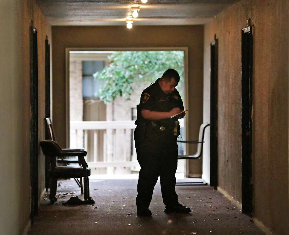 Bexar County Deputy Constable Edward Prado of Precinct 4 serves an eviction notice to residents at Spanish Oaks Apartments, a Bexar Met property. Photo: Bob Owen / San Antonio Express-News