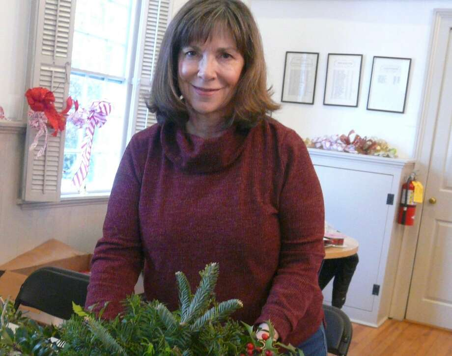 Marla Sinchak joins with other Wilton Garden Club members in creating holiday decorations. Photo: Contributed Photo / Wilton Garden Club / Wilton Bulletin Contributed