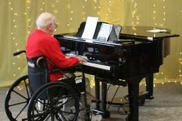 Pictured is Dr. Charles Crown playing the piano at a Summer Showcase performance in the Summer of 2018 at the Waveny LifeCare Network building, which is located at 3 Farm Road in New Canaan, Connecticut.