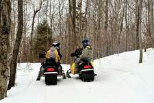 According to the Michigan Department of Natural Resources, state-designated snowmobile trails opened on Sunday, and will remain open until March 31. (Courtesy photo/Getty Images)