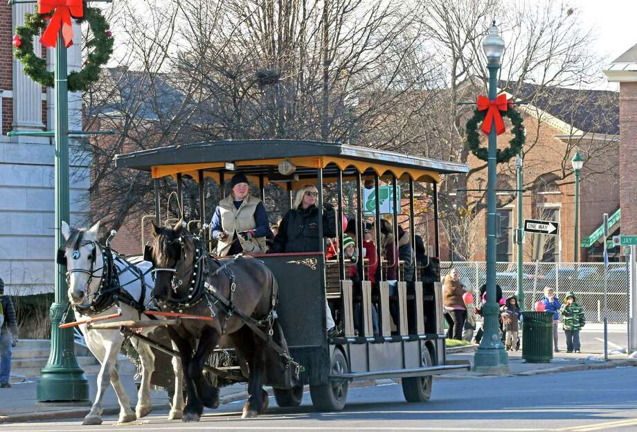 Rose and Bow of Saratoga Horse and Carriage Co. pull the carriage around City Hall during Schenectadya€™s City Hall-iday on Saturday Dec. 10, 2016 in Schenectady, N.Y. (Michael P. Farrell/Times Union) Photo: Michael P. Farrell / 20039040A