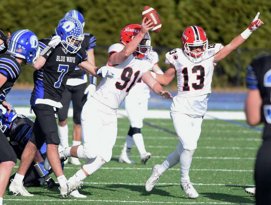 New Canaan's Braden Sweeney (91) and Walker Swindell (13) celebrate Sweeney's interception during the annual Turkey Bowl football game between Darien and New Canaan at Darien High School on Thursday, Nov. 28, 2019. Photo: Dave Stewart / Hearst Connecticut Media / Hearst Connecticut Media