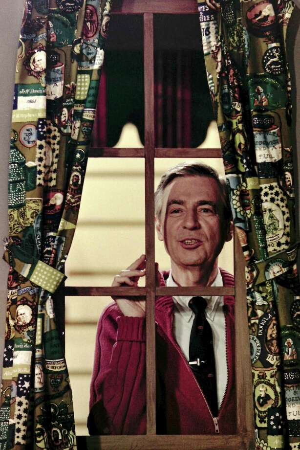 Fred Rogers looking through the window on his television house during the taping of a segment for his children's television program, Mister Rogers' Neighborhood, in Pittsburgh, June 28, 1989. A reader is thankful for Mr. Rogers' moral teachings. Photo: Gene J. Puskar /Associated Press / Copyright 2010 The Associated Press. All rights reserved