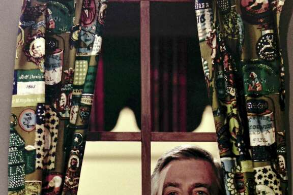 Fred Rogers looking through the window on his television house during the taping of a segment for his children's television program, Mister Rogers' Neighborhood, in Pittsburgh, June 28, 1989. A reader is thankful for Mr. Rogers' moral teachings.