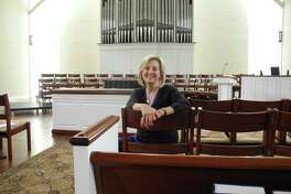 Wilton Presbyterian Pastor the Rev. Shannon White sits in the church sanctuary.