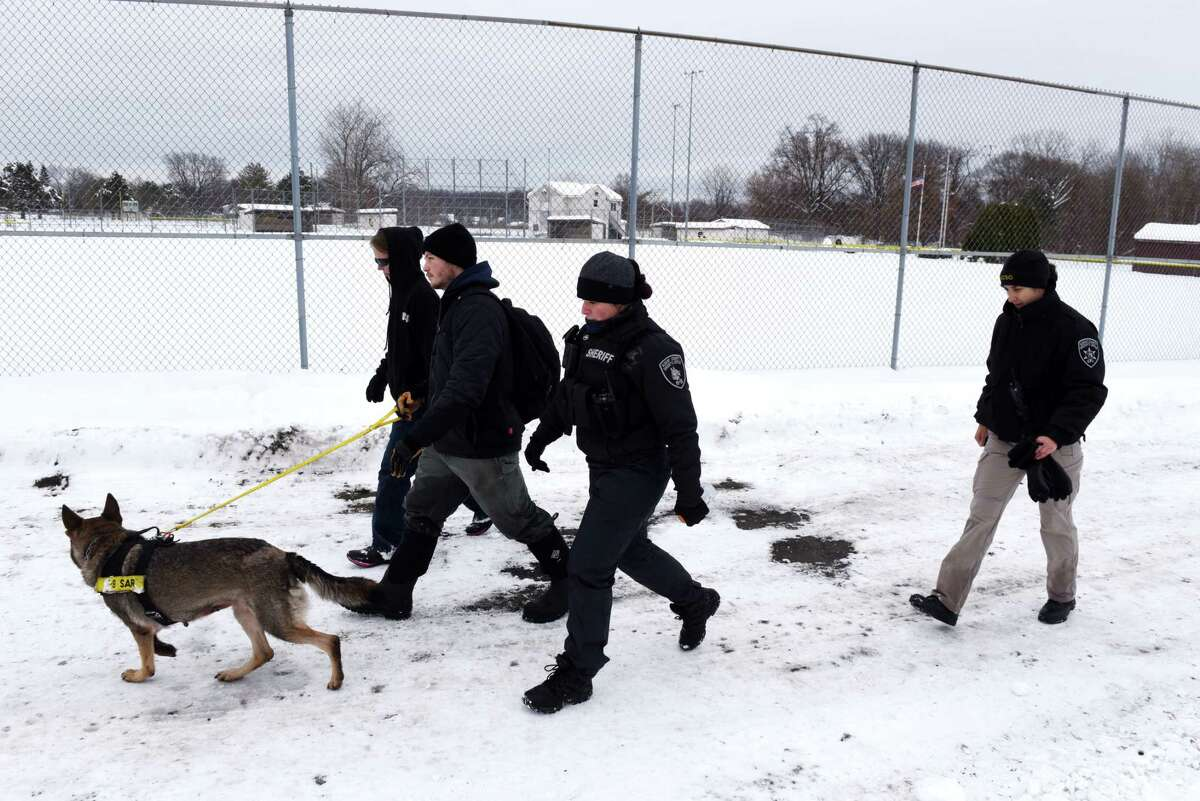Law enforcement members from the Albany County Sheriff's Office search West Albany Pocket for a missing woman on Wednesday, Dec. 4, 2019, in Colonie, N.Y. Beverly A. Trombley has not been seen since Saturday. Her car was found near the pocket park. (Will Waldron/Times Union)