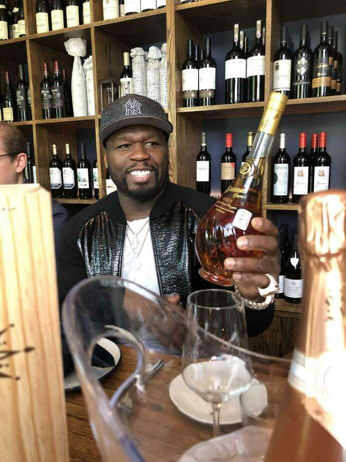Rapper 50 Cent will be at three Houston-area Spec's Wines, Spirits and Finer Foods promoting his line of cognac and champagnes. Photo: Dale Robertson / Contributor