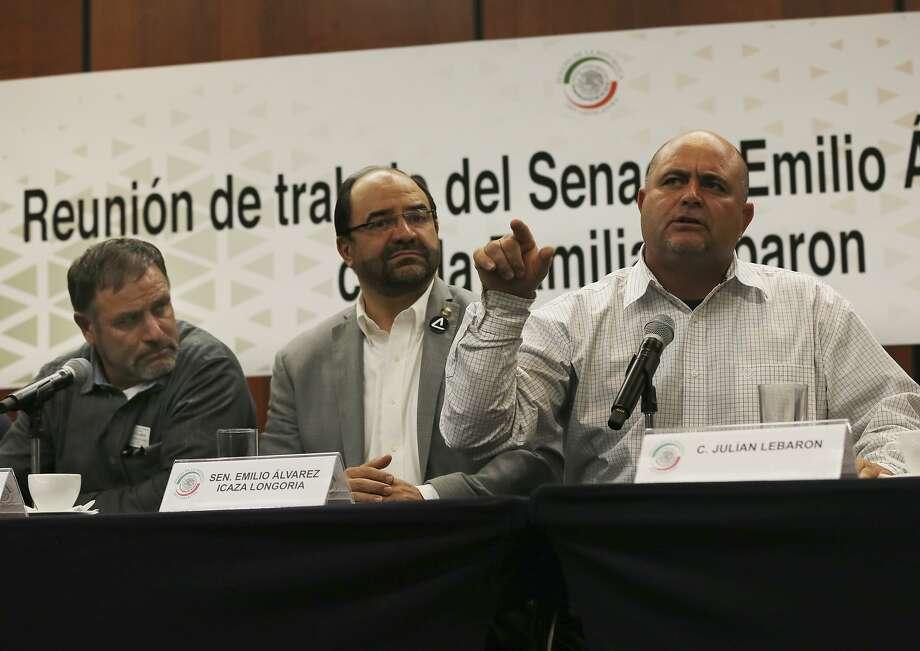 From left: Adrian LeBaron, Sen. Emiliano Alvarez and Julian LeBaron speak to reporters in Mexico City. Photo: Marco Ugarte / Associated Press