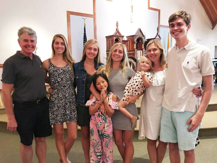 The Meyer family, from left: Eric, Emily, Caroline, Eliza, Courtney, Baby Scarlett, Mary Ellen and Chris Meyer. Photo: New England Academy Of Dance / Contributed Photo / New Canaan Advertiser Contributed