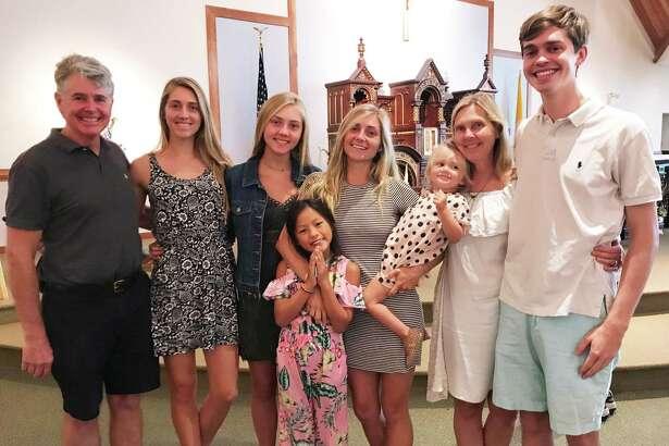 The Meyer family, from left: Eric, Emily, Caroline, Eliza, Courtney, Baby Scarlett, Mary Ellen and Chris Meyer.