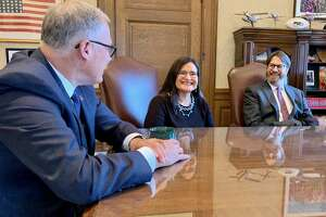 Gov. Jay Inslee meets with Judge Raquel Montoya-Lewis moments before he officially announces her appointment to the Washington State Supreme Court. (Office of the Governor photo)