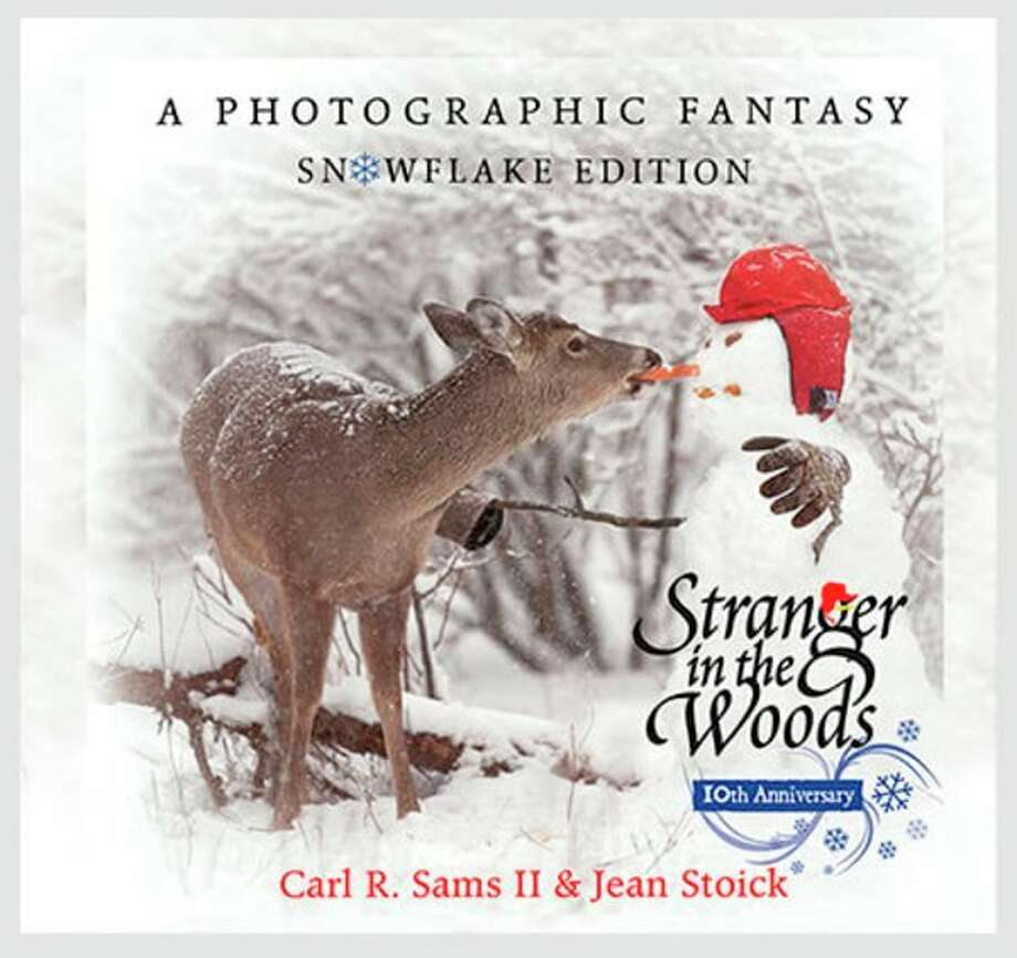"Titles, already signed, include a special 3-D edition of ""Stranger in the Woods,"" which started the popular ""In the Woods"" series, ""Lost in the Woods,"" a book celebrating spring, ""A Magical Winter,"" which reveals a white, white-tailed deer, ""Children in the Woods,"" about summertime, and ""I am Africa,"" which showcases animals from a trip to Kenya. (Photo provided/Carl Sams)"