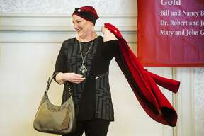 Wendy High models an outfit during Cancer Services of Midland's 28th Annual Holiday Luncheon & Style Show Wednesday, Dec. 4, 2019 at Midland Country Club. (Katy Kildee/kkildee@mdn.net)