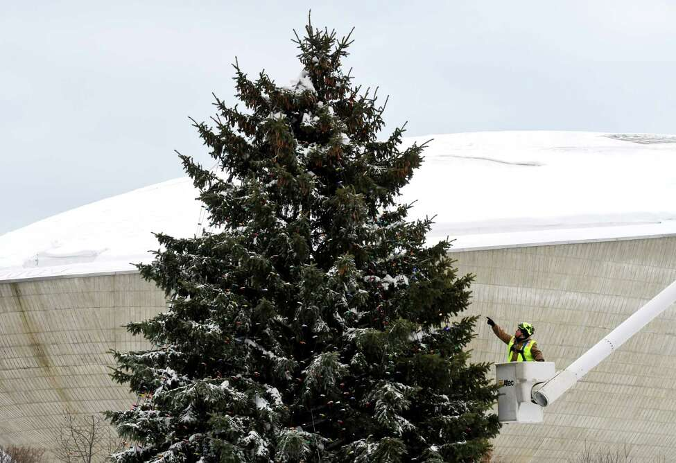 Lights are strung on the New York State holiday tree on Wednesday, Dec. 4, 2019, at Empire State Plaza in Albany N.Y. A tree lighting and fireworks ceremony will take place on Sunday at 5:15 p.m., with events beginning at noon. (Will Waldron/Times Union)