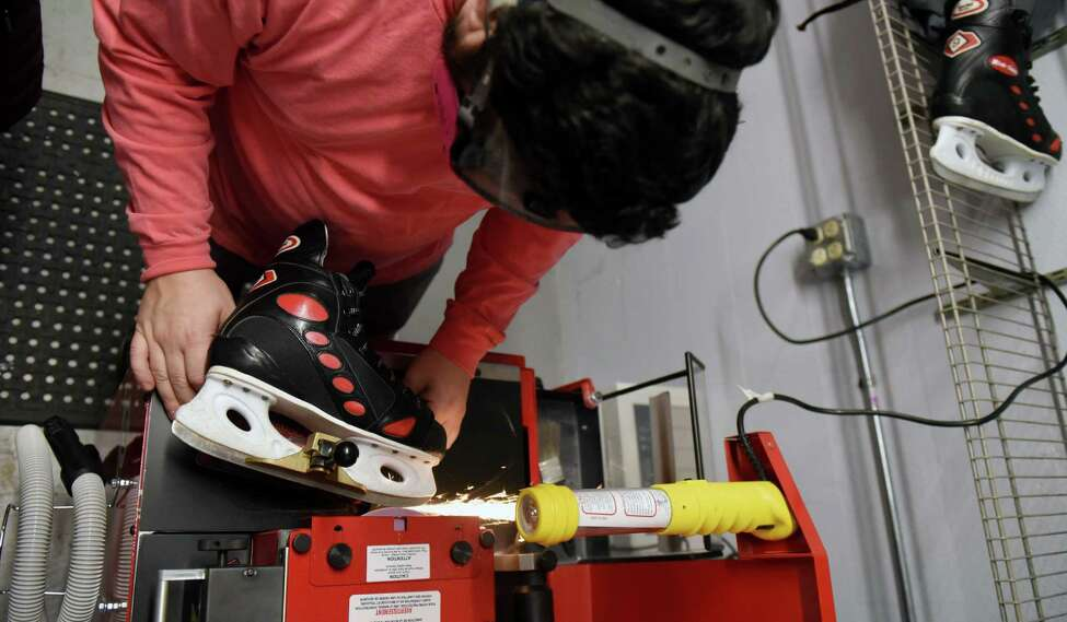 Nick DeBlois sharpens rental skates for the Empire Skate Plaza ice rink on Wednesday, Dec. 4, 2019, at Empire State Plaza in Albany N.Y. The rink is scheduled to open Friday lunchtime, weather permitting. (Will Waldron/Times Union)