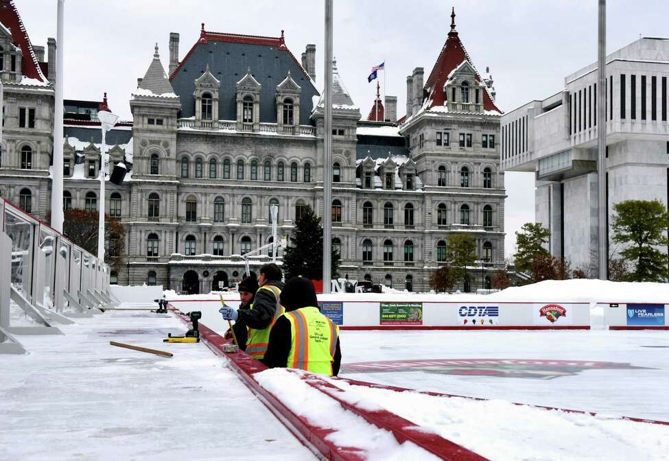 Workers from the New York State Office of General Services prepare the Empire Skate Plaza ice rink for operation on Wednesday, Dec. 4, 2019, at Empire State Plaza in Albany N.Y. The rink is scheduled to open Friday lunchtime, weather permitting. (Will Waldron/Times Union)