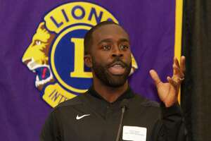 Caney Creek head basketball coach Randy Appiah speaks during the Conroe Noon Lions Club's annual Roundball Roundup with area boys basketball coaches at the Lone Star Convention & Expo Center, Wednesday, Dec. 4 2019, in Conroe.