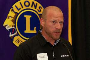Lake Creek head coach Shannon Spence speaks during the Conroe Noon Lions Club's annual Roundball Roundup with area boys basketball coaches at the Lone Star Convention & Expo Center, Wednesday, Dec. 4 2019, in Conroe.