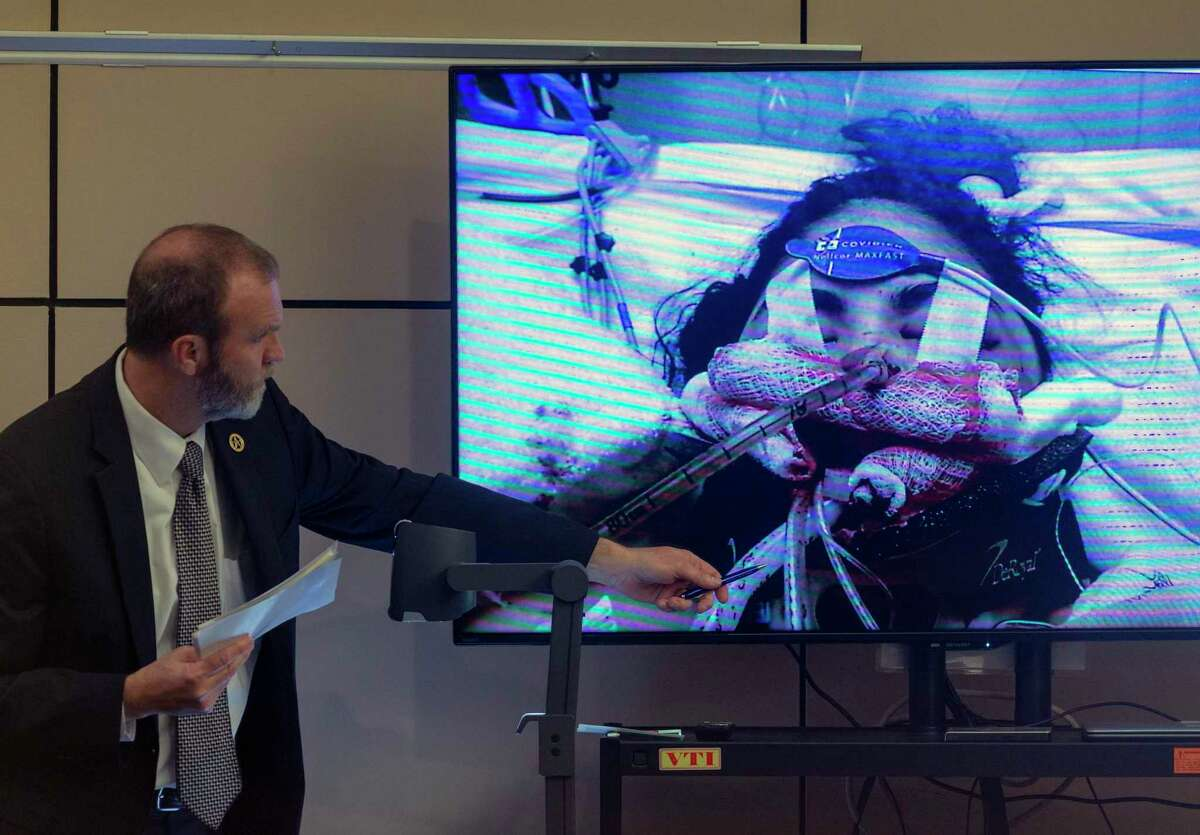 Prosecutor David Lunan displays a photo Wednesday, Dec. 4, 2019, in the 144th state District Court in the Cadena-Reeves Criminal Justice Center of Cayley Mandadi during the murder trial of Mark Howerton. Howerton is alleged to have beaten Mandadi, a 19-year-old Trinity University cheerleader, to death in 2017.