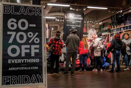 Shoppers at a Los Angeles clothing store look for early bargains as Black Friday sales began on Thanksgiving Day.