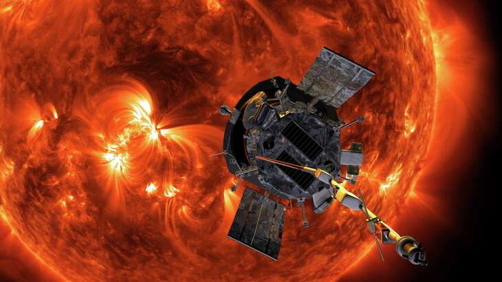 This image made available by NASA shows an artist's rendering of the Parker Solar Probe approaching the Sun. It's designed to take solar punishment like never before, thanks to its revolutionary heat shield that's capable of withstanding 2,500 degrees Fahrenheit (1,370 degrees Celsius). (Steve Gribben/Johns Hopkins APL/NASA via AP)