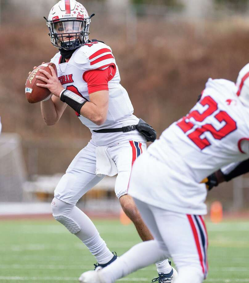 Foran quarterback Andrew Janik led the Lions to four touchdowns and a field goal on Thanksgiving. Photo: David G. Whitham / For Hearst Connecticut Media / Milford Mirror