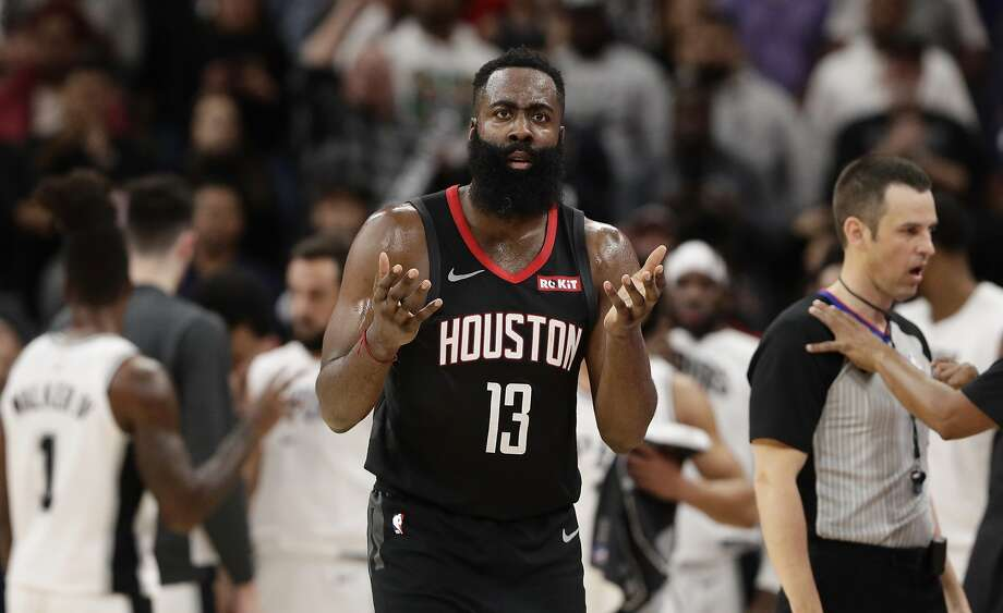 Houston Rockets guard James Harden questions a call during the second half of a game against the San Antonio Spurs. San Antonio won 135-133 in double overtime. Photo: Eric Gay, Associated Press