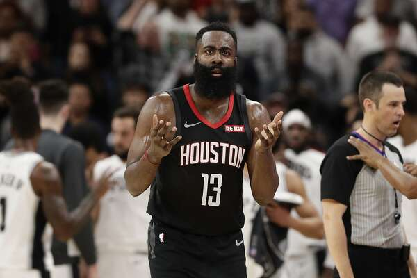 Houston Rockets guard James Harden (13) questions a call during the second half of an NBA basketball game against the San Antonio Spurs, in San Antonio, Tuesday, Dec. 3, 2019. San Antonio won 135-133 in double overtime. (AP Photo/Eric Gay)