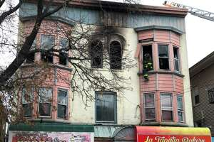 New Haven firefighters battled a fire at 306 Grand Avenue Wednesday afternoon.