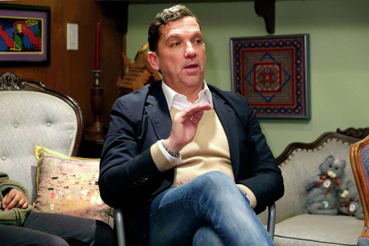 Houston mayoral runoff candidate Tony Buzbee sits with area residents as he speaks in a University Oak home to some 20 attendants during their neighborhood association meeting Wednesday, Nov. 13, 2019 in Houston, TX.