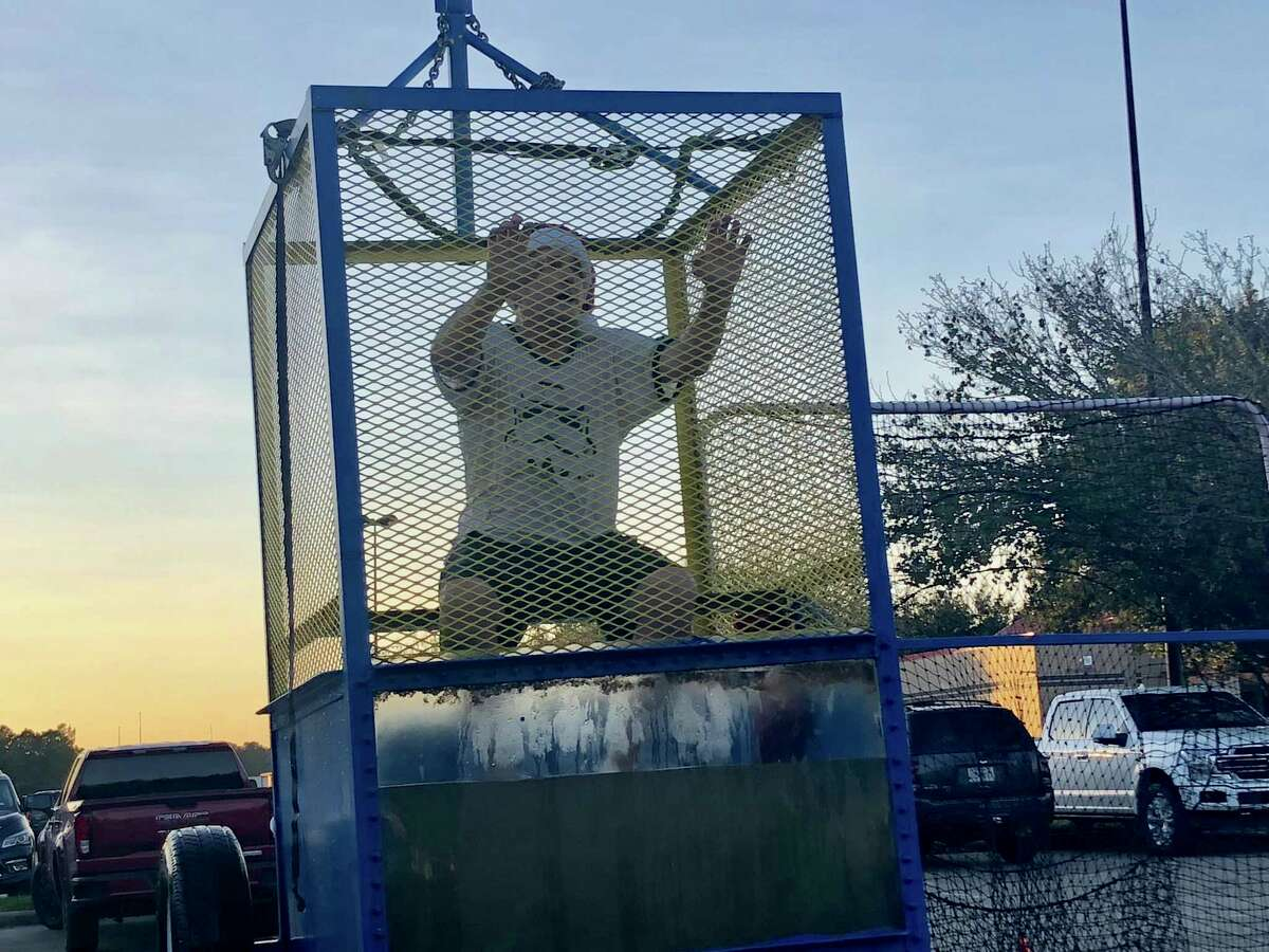 Crosby ISD superintendent Scott Davis took a shift in the dunking booth during the Crosby Education Foundation's Dunk-A-Dude fundraiser on Dec. 2. He playfully teased the students that were trying to dunk him.
