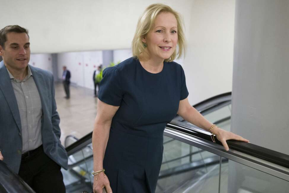 Sen. Kirsten Gillibrand, D-N.Y., right, heads to the Senate for a vote, on Capitol Hill, Tuesday, Sept. 24, 2019 in Washington.