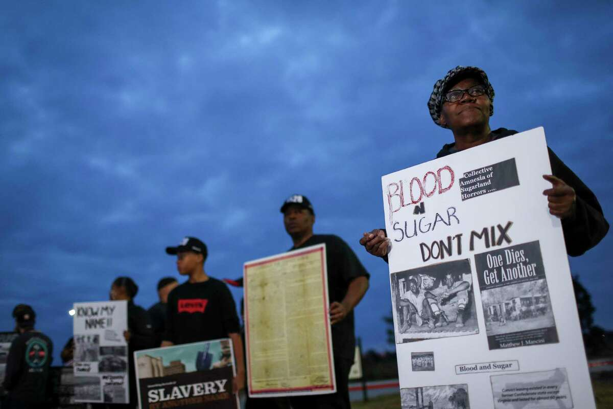 Plans to honor the remains of 95 African Americans whose remains were found at a Fort Bend ISD construction site before they were reinterred drew protesters such as Terri Collins, right, on Sunday, Nov. 17, 2019, in Sugar Land. Many wanted the district to delay reburial until the remains could be identified. The remains are believed to belong mostly to men were part of Texas' notorious convict-leasing program, in which prisoners were contracted out to perform cheap labor, often under brutal conditions. The Fort Bend ISD in September 2020 released a report with information on 72 of those whom they believe to be buried on the site.