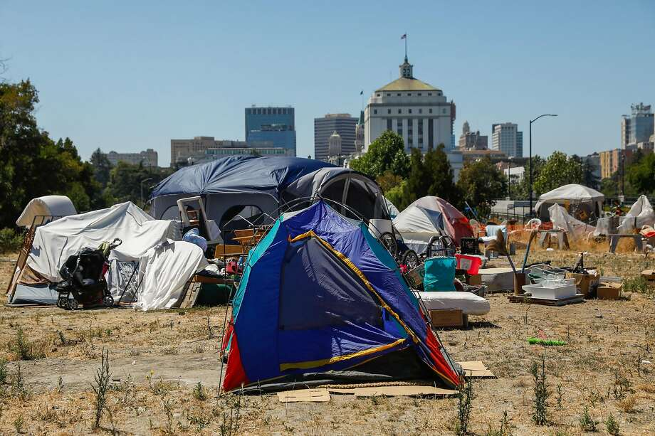 Tents are seen at an encampment on East 12th Street in Oakland, California, on Wednesday, July 24, 2019. Photo: Gabrielle Lurie / The Chronicle 2019