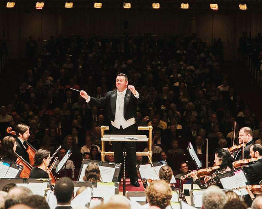 Collinsville Chorale Artistic Director Andy Waggoner leading members of the Collinsville Chorale, as well as vocalists from various other choirs, last year, at Carnegie Hall. Photo: For The Telegraph