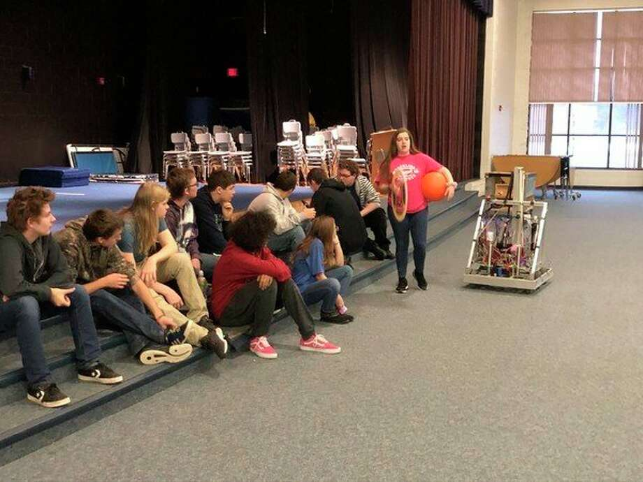 Brethren High School Robotics team members work with their robot last year. A new season will be starting in January. (Courtesy photo)