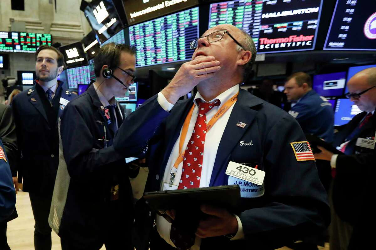 Trader Frederick Reimer works on the floor of the New York Stock Exchange, Wednesday, Dec. 4, 2019. Stocks are opening broadly higher as traders became more hopeful that a trade deal between the U.S. and China was making progress. (AP Photo/Richard Drew)