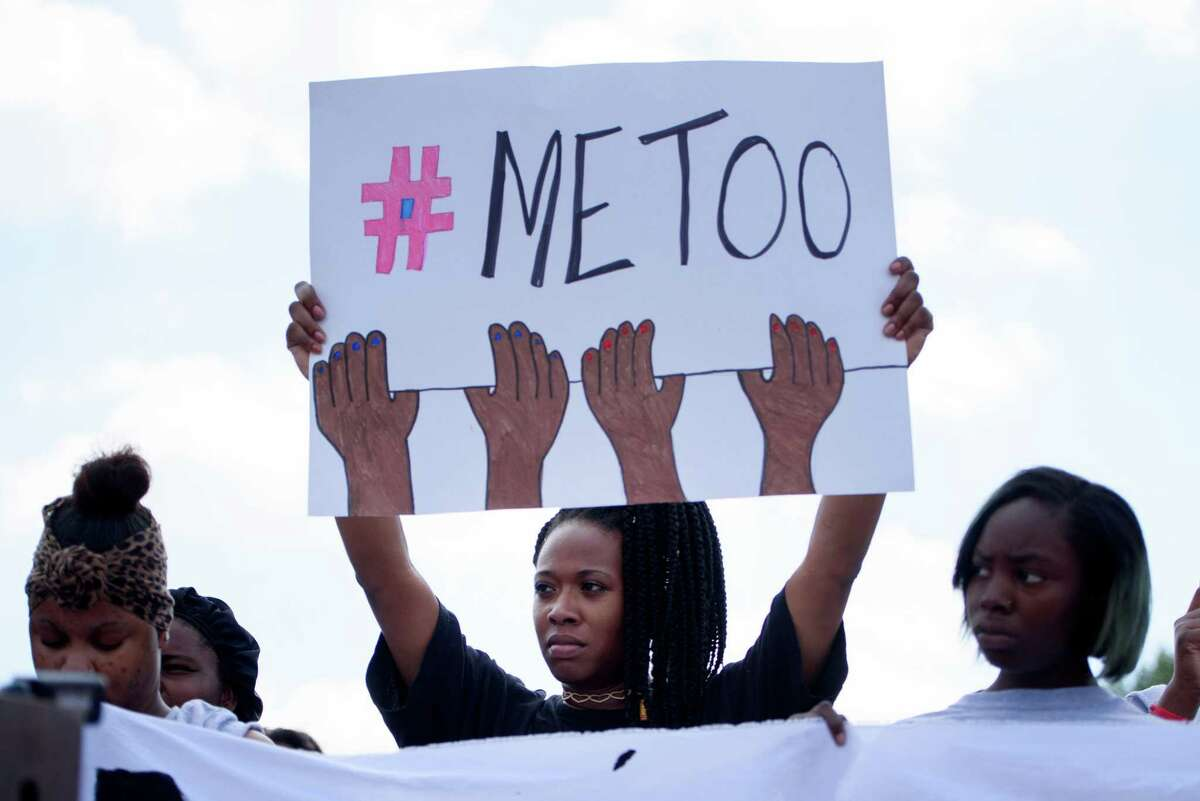 Charde Jackson, center, a fast-food worker, holds a sign during a demonstration against sexual harassment, at a McDonald's in St. Louis, Sept. 18, 2018. The nation-wide strike, started by the organization Fight for 15, comes after McDonald's workers filed charges against the company in May. (Nick Schnelle/The New York Times)