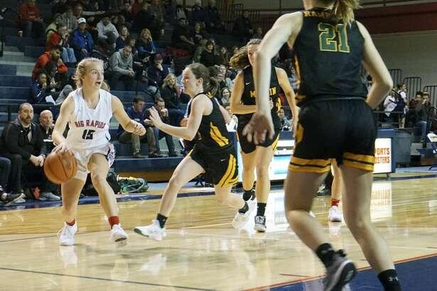 Big Rapids' girls basketball team defeated McBain 49-45 to open the regular season on Tuesday night at the Big Rapids High School gym.