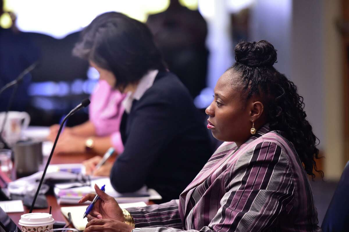 City Council member Jada Andrews-Sullivan takes notes during Police Chief William McManus breifing of the City Council's public safety committee about an overall 16% decrease in the San Antonio crime rate.